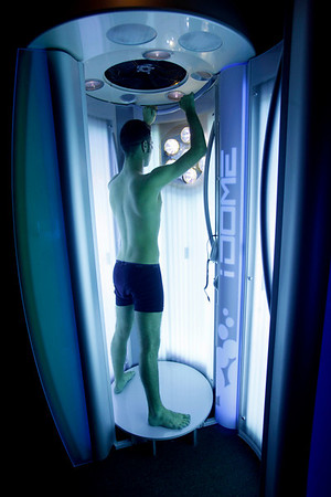 Joe Bongioni works on his tan in a  tanning booth in New York, Wednesday, March 24, 2010.  A 10 percent sales tax on indoor tanning, which takes effect this year, is helping to pay for the health care overhaul.  (AP Photo/Seth Wenig)