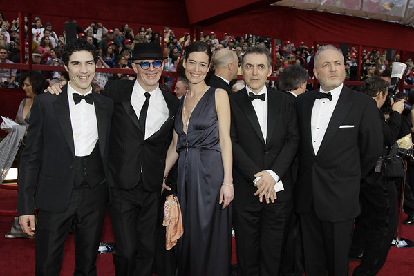 "French director Jacques Audiard, second from left, is joined by cast and producers of his nominated film ""Un Prophète,"" as he arrives at the 82nd Academy Awards Sunday,  March 7, 2010, in the Hollywood section of Los Angeles. (AP Photo/Amy Sancetta)"