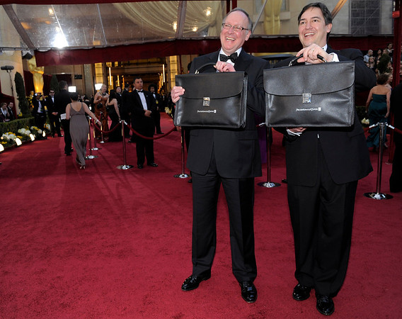 Representatives of PriceWaterhouseCoopers arrive with the Oscar announcements at 82nd Academy Awards Sunday,  March 7, 2010, in the Hollywood section of Los Angeles. (AP Photo/Chris Pizzello)