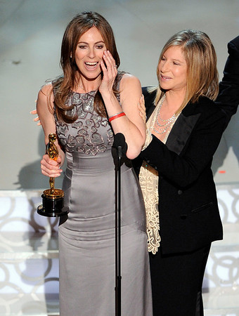"""Kathryn Bigelow accepts the Oscar for best achievement in directing for """"The Hurt Locker"""" from presenter Barbra Streisand at the 82nd Academy Awards Sunday, March 7, 2010, in the Hollywood section of Los Angeles. (AP Photo/Mark J. Terrill)"""