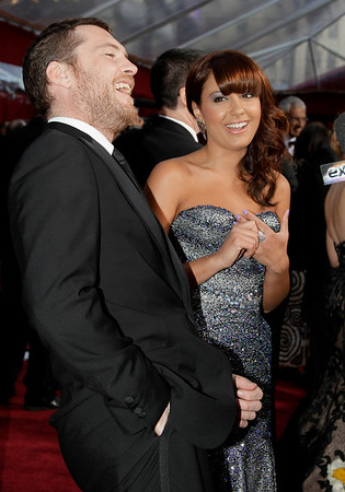 Sam Worthington, left, and Natalie Mark arrives at the 82nd Academy Awards Sunday,  March 7, 2010, in the Hollywood section of Los Angeles. (AP Photo/Amy Sancetta)