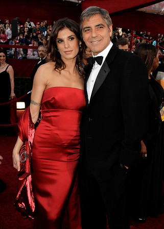 George Clooney, right, and Elisabetta Canalis arrive at the 82nd Academy Awards Sunday,  March 7, 2010, in the Hollywood section of Los Angeles. (AP Photo/Amy Sancetta)