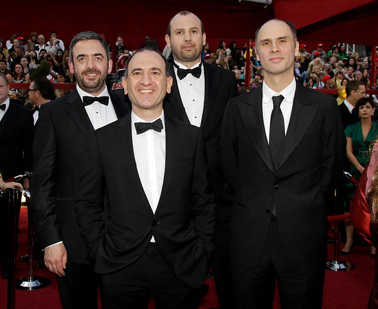 """In The Loop"" writing nominees, from left, Tony Roche, Armando Ianucci, Simon Blackwell, and Jesse Armstrong arrive at the 82nd Academy Awards Sunday,  March 7, 2010, in the Hollywood section of Los Angeles. (AP Photo/Amy Sancetta)"