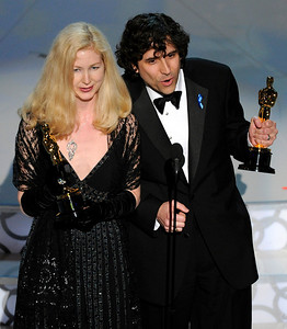 "Bob Murawski, right, and Chris Innis accept the Oscar for best achievement in film editing for ""The Hurt Locker"" at the 82nd Academy Awards Sunday, March 7, 2010, in the Hollywood section of Los Angeles. (AP Photo/Mark J. Terrill)"