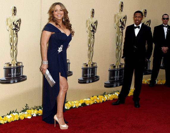 Mariah Carey and Nick Cannon arrive during the 82nd Academy Awards Sunday,  March 7, 2010, in the Hollywood section of Los Angeles. (AP Photo/Matt Sayles)