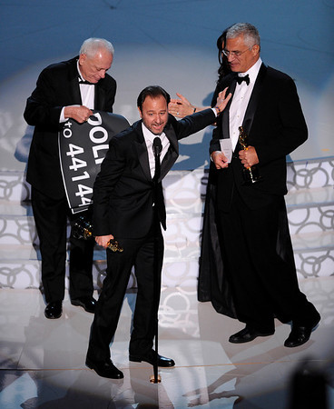 """From left are Ric O'Barry, Fisher Stevens, and Louie Psihoyos are seen on stage as the accept the award for best documentary feature for """"The Cove"""" at the 82nd Academy Awards Sunday,  March 7, 2010, in the Hollywood section of Los Angeles. (AP Photo/Mark J. Terrill)"""