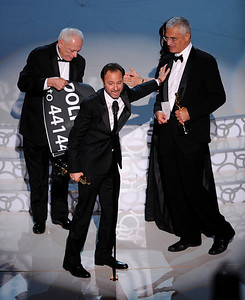 "From left are Ric O'Barry, Fisher Stevens, and Louie Psihoyos are seen on stage as the accept the award for best documentary feature for ""The Cove"" at the 82nd Academy Awards Sunday,  March 7, 2010, in the Hollywood section of Los Angeles. (AP Photo/Mark J. Terrill)"