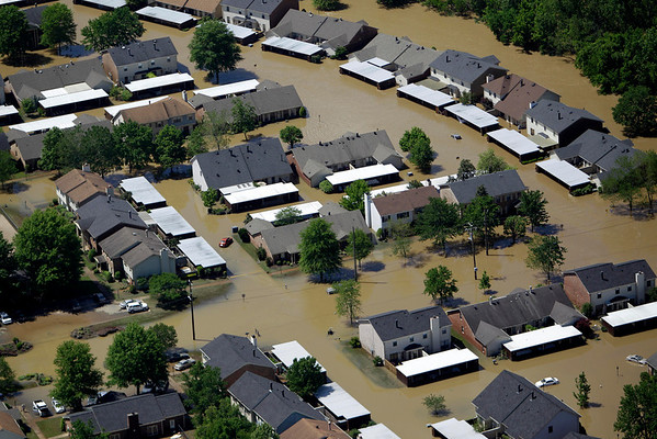 A flooded neighborhood in Nashville, Tenn., is seen Monday, May 3, 2010. After heavy weekend rains and flooding, officials in Tennessee are preparing for the Cumberland River, which winds through Nashville, to crest more than 11 feet Monday afternoon.  (AP Photo/Mark Humphrey)