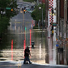 Pedestrians are seen near floodwater Monday, May 3, 2010, in Nashville, Tenn. Heavy weekend rain caused the Cumberland River, which winds through Nashville, to over flow its banks flooding part of downtown and other areas around the city.  (AP Photo/Jeff Roberson)