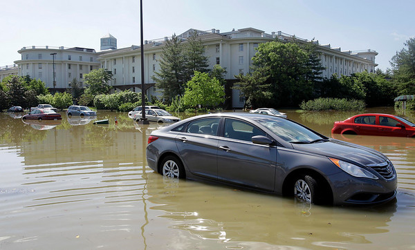 Cars sit in flood water at the Opryland Hotel in Nashville, Tenn., on Monday, May 3, 2010. After heavy weekend rains and flooding, officials in Tennessee are preparing for the Cumberland River, which winds through Nashville, to crest Monday. (AP Photo/Mark Humphrey)