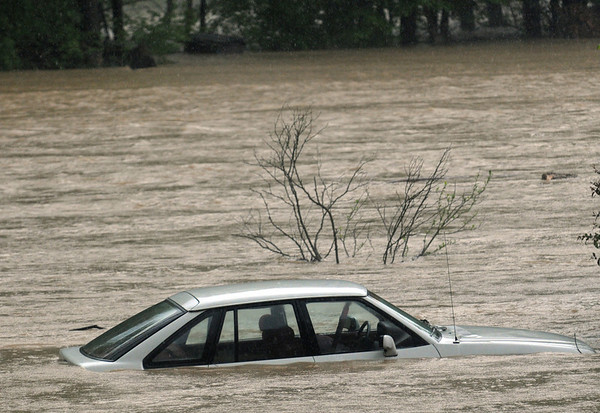 Severe Weather.JPEG-03186.JPG A car is caught in a creek normally contained behind the tree during flooding Sunday May 2, 2010, along KY 377 in Morehead, Kentucky. Heavy rains in Rowan and Lewis Counties have caused many streams to leave their  banks. (AP Photo/The Independent, John Flavell)