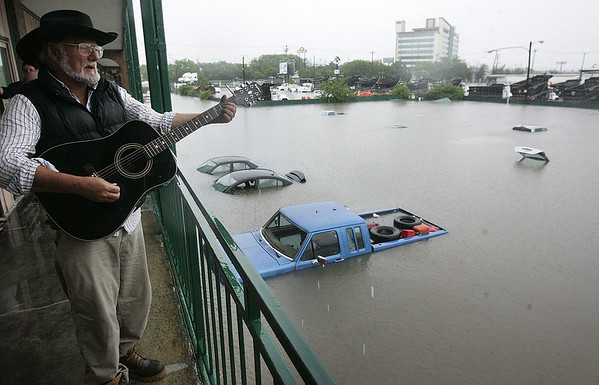 Dover Anthony sings on as he overlooks the parking lot of submerged cars at the Knights Motel in East Nashville, Sunday, May 2, 2010. (AP Photo/The Tennessean, John Partipilo)