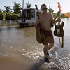Severe Weather.JPEG-0a121.JPG David Sesler carries his guitars through floodwater after recovering them from his flooded home using his houseboat, Monday, May 3, 2010, in Nashville, Tenn. After heavy weekend rains and flooding, officials in Tennessee are preparing for the Cumberland River, which winds through Nashville, to crest sometime Monday afternoon. (AP Photo/Jeff Roberson)