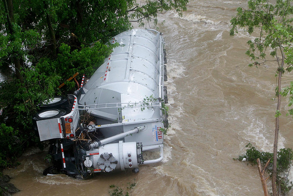 A tanker truck is pushed against trees after being washed away, Sunday, May 2, 2010 in Nashville, Tenn. Severe storms dumped heavy rain on Tennessee for the second straight day. (AP Photo/Mark Humphrey)