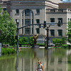 A woman walks past flooding outside the Schermerhorn Symphony Center in downtown Nashville, Tenn., Monday, May 3, 2010. (AP Photo/The Tennessean, Larry McCormackl)