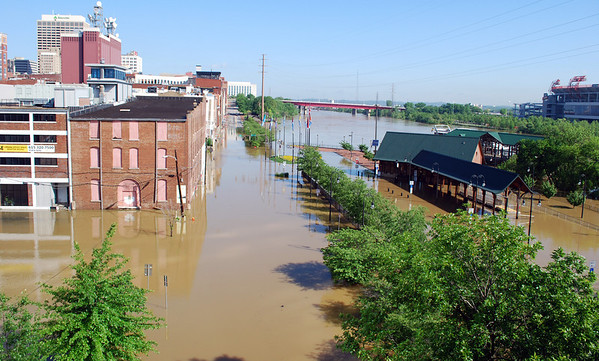 Parts of downtown  Nashville, Tenn. are flooded, near the Cumberland River on Monday, May 3, 2010. The Cumberland River continues to rise at Nashville, but is nearing its crest. Floodwater has spilled onto a couple of downtown streets near the riverfront and restaurants and bars in the tourist district are closed.   (AP Photo/Kristin M. Hall )