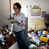 Lighthouse Christian School teacher Heather Harrell reacts after finding her grandmother's Bible in her classroom that was destroyed by the flood  in Antioch, Tenn.  on Monday, May 3, 2010.    The Cumberland River continues to rise at Nashville, but is nearing its crest. Floodwater has spilled onto a couple of downtown streets near the riverfront and restaurants and bars in the tourist district are closed.     (AP Photo/The Tennessean, Shelley Mays)