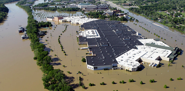 The Opry Mills shopping complex is surrounded by flood water from the Cumberland River, left, in Nashville, Tenn., on Monday, May 3, 2010. After heavy weekend rains and flooding, officials in Tennessee are preparing for the Cumberland River, which winds through Nashville, to crest more than 11 feet Monday afternoon.  (AP Photo/Mark Humphrey)