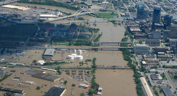 Buildings stand in flood water in downtown Nashville, Tenn., on Monday, May 3, 2010. After heavy weekend rains and flooding, officials in Tennessee are preparing for the Cumberland River, which winds through Nashville, to crest Monday. (AP Photo/The Tennessean, Samuel M. Simpkins)