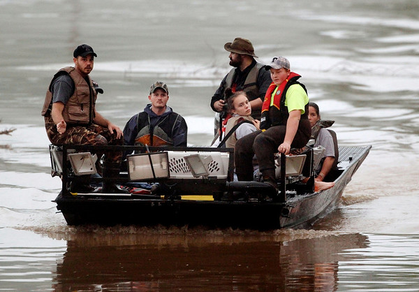 People are brought across flood waters from the Somerset Farms subdivision on Sunday, May 2, 2010, in Nashville, Tenn. Flooding cut off access to Somerset Farms and residents were evacuated.  Severe storms dumped heavy rain on Tennessee for the second straight day. (AP Photo/Mark Humphrey)