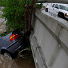 A car is washed up against a tree under a bridge on Sunday, May 2, 2010 in Nashville, Tenn. Severe storms dumped heavy rain on Tennessee for the second straight day. (AP Photo/Mark Humphrey)