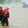 Warren County Rescue Department Chief Andy Tucker, right,  and rescue member Jason Pugh wade through high water, Sunday, May 2, 2010, to pull out a truck that got stuck in the water in Bowling Green, Ky. South Central Kentucky received nearly 10 inches of rain in two days. (AP Photo/Bowling Green Daily News, Hunter Wilson)