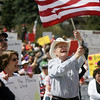 "Roger Warrick, 71, from Boise, waves his flag on the state capitol steps in downtown Boise, Idaho during a Tea Party Boise tax day rally on Thursday, April 15, 2010. ""I'm really worried about the way this country is headed,"" said Warrick. "" I see this country moving further and further to the left, in fact, I almost think it's moving toward communism. And I look at my grandchildren in which I have 23 and I see the debt that's piling up under this administration and I just feel so bad for my children and grandchildren. We need to get involved and change this and we need to get back to the conservative principles that built this country."" (AP Photo/The Idaho Statesman, Shawn Raaecke)"
