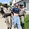 "TMartin Francis Brown, 45, is arrested at a tea party rally at the Capitol in Sacramento, Calif. on Thursday, April 15, 2010.  ""Give me my freedom,"" he yelled on stage as a speaker was addressing the crowd. Officers Rick Turner, left and Jeff Lane said they ""arrested him for demonstration without a permit and resisting arrest."" (AP Photo/The Sacramento Bee, Hector Amezcua)"