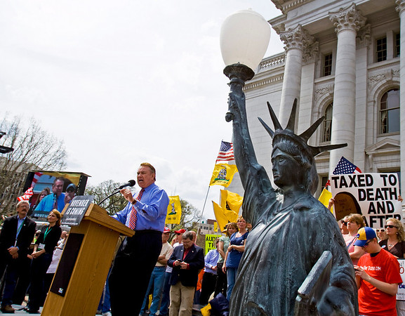 Former Wisconsin Gov. Tommy Thompson addresses a tea party rally Thursday, April 15, 2010, in Madison, Wis.  Thompson ended months of speculation Thursday by saying he wanted to run for U.S. Senate but ultimately decided against it.  (AP Photo/Andy Manis)