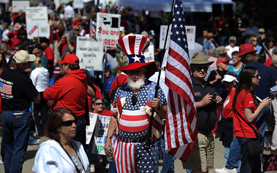 Michael Keesling of Elk Grove, Calif., dressed as Uncle Sam, prepares to take part in the Tea Party rally at the state Capitol on Thursday, April 15, 2010, in Sacramento. (AP Photo/The Sacramento Bee, Hector Amezcua)