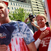 Mark Herr of Memphis, Tenn., left, and Claudia Schuster, of Selersburg, Ind., say the Pledge of Allegiance while attending a tea party protest in Washington, Thursday, April 15, 2010. (AP Photo/Jacquelyn Martin)