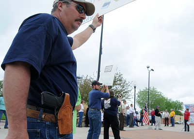 New Mexico rancher Mark Kelley packs a handgun during a Tax Day protest, Thursday, April 15, 2010 at Pioneer Plaza in Roswell, N.M..  (AP Photo/Roswell Daily Record  Mark Wilson)