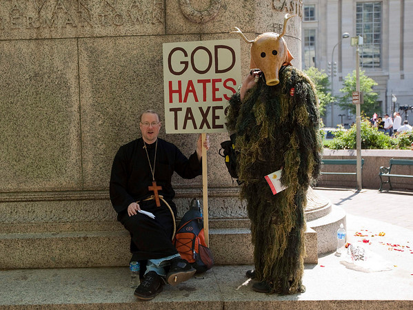 "Dave Parnell, left, and James Bickford, both of Holyoke, Mass., gather at Freedom Plaza in Washington, Thursday, April 15, 2010, for a Tea Party rally near the Capitol.  They call themselves ""cultural jammers"" and dressed up to add to the spectacle of the event.  (AP Photo/Evan Vucci)"