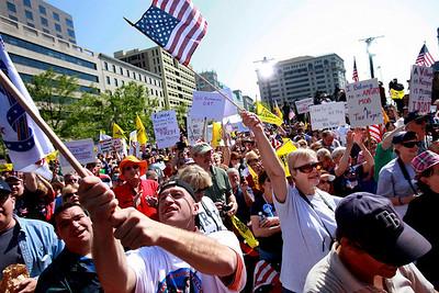 People attend a tea party protest in Washington, Thursday, April 15, 2010. (AP Photo/Jacquelyn Martin)
