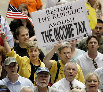People attend a tea party tax day rally in Nashville, Tenn., on Thursday, April 15, 2010, the day income taxes are due. (AP Photo/Mark Humphrey)