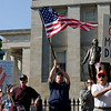 People gather for a Tea Party protest on Thursday April 15, 2010 on the grounds of the State Capital in Raleigh, N.C. Part of the lively crowd reacts as organizer Laura Long begins the program. (AP Photo/The News & Observer, Robert Willett)