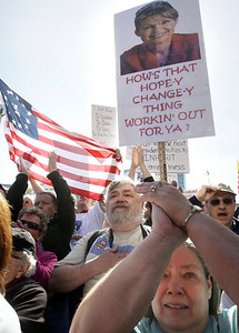 Supporters applaud prior to an address by Sarah Palin during a stop of the Tea Party Express on Boston Common in Boston, Wednesday, April 14, 2010. (AP Photo/Charles Krupa)