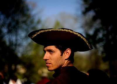 """John Geary of Churchville, Va. wears a tricorne hat during a tax day tea party rally in Staunton, Va. on Thursday, April 15, 2010. Geary said he was tired of """"out-of-control spending, it's unsustainable."""" (AP Photo/The Daily News Leader, Pat Jarrett)"""