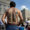 Darryl Herbertz, of Moorseville, Ind., displays his tattoo with the text of the Second Amendment, along with ofter images of protest during a tea party rally outside the Statehouse in Indianapolis, Thursday, April 15, 2010. (AP Photo/Michael Conroy)