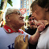 Tea party supporter Harris Klein, left, of Pembroke Pines, Fla. gets into a shoving match with someone opposed to the tea party movement, who did not want to give his name, Thursday, April 15, 2010, in front of the U.S. Federal Courthouse in Ft. Lauderdale, Fla. (AP Photo/Sun-Sentinel, Joe Cavaretta)
