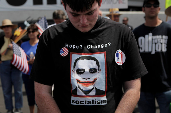 Adin Rudd, 18, of Glendora, Calif., prays at a tea party rally in Irvine, Calif., Thursday, April 15, 2010. (AP Photo/Jae C. Hong)