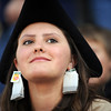 Tea party supporter Courtney Tiedemann, 17, of Bailey, Colo. wears tea bags as earrings and a tricorn hat during a rally at the State Capitol in Denver, Colo. on Thursday, April 15, 2010. Tiedemann says she will be 18 for November's election. Thousands were in attendance as well as protestors of the rally. (AP Photo/The Denver Post, Matt McClain)