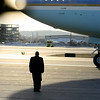 A member of the White House Staff stands at attention as President Barack Obama prepares to fly out on Air Force One, in Manchester, N.H., on Tuesday, Feb. 2, 2010, after attending a town hall meeting in Nashua, N.H.   (AP Photo/Cheryl Senter)