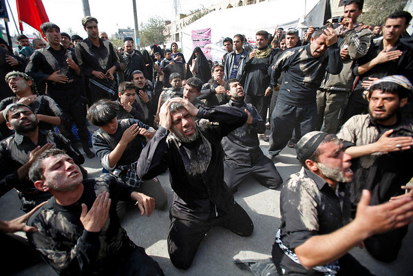 Iraqi Shiite pilgrims beat themselves to mark Arbaeen, one of the holiest days in their religious calendar in the holy city of Karbala, Iraq, Wednesday, Feb. 3, 2010. A bomb planted on a parked motorcycle exploded on the outskirts of Karbala amid tight security for the huge religious procession. (AP Photo/Hadi Mizban)