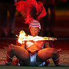 A performer of Trinidad does the limbo under a flaming bar while rehearsing for the Edinburgh Military Tattoo, a military music festival,  in Sydney, Australia, Wednesday, Feb. 3, 2010. More than 1500 performers from Australia, The United Kingdom, Russia, China, The United States, Norway, Switzerland and more marched onto the Sydney Football Stadium for the final dress rehearsal ahead of opening night, Thursday Feb. 4, 2010. (AP Photo/Rob Griffith)