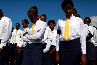 APTOPIX_Haiti_Earthquak(3).JPG Members of a choir pause while attending a memorial service for the Haiti's earthquake victims that were dumped in a mass grave in Titanyen, outside Port-au-Prince, Monday, Feb. 1, 2010. A 7.0-magnitude earthquake hit Haiti on Jan. 12, killing and injuring thousands. (AP Photo/Rodrigo Abd)