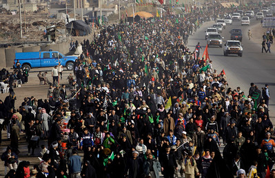 APTOPIX_Iraq_Pilgrims_BAG10.JPG Shiite pilgrims file into the holy city of Karbala, 80 kilometers (50 miles) south of Baghdad, Iraq, Monday, Feb. 1, 2010, as faithful gather for Arbaeen, which marks the end of the forty-day mourning period after the anniversary of the 7th century martyrdom of Imam Hussein, the Prophet Muhammad's grandson. A female suicide bomber walking among Shiite pilgrims in Baghdad detonated an explosives belt on Monday, killing scores and wounding more than 100, officials said. The bombing was the first major strike this year against pilgrims making their way to the southern city of Karbala to mark a Shiite holy day. It came as security official warned of a possible increase in attacks by insurgents using new tactics to bypass bomb-detection methods. (AP Photo/Hadi Mizban)