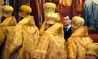 APTOPIX_Russia_Patriarch_MO.JPG Russian President Dmitry Medvedev looks on as he attends a ceremony at the Christ the Savior Cathedral during a celebration of the  first anniversary of the enthronement of Patriarch Kirill , Patriarch of Moscow and All Russia and Primate of the Russian Orthodox Church, in Moscow, Monday, Feb. 1, 2010. (AP Photo/ Natalia Kolesnikova, Pool)
