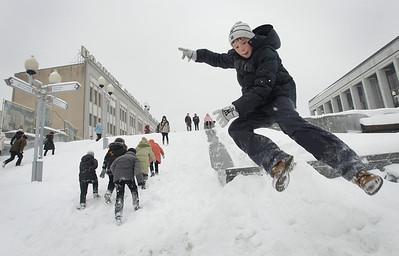 APTOPIX_BELARUS_WEATHER(2).JPG Children enjoy a slide on a little hill after a heavy snowfall in Minsk, Belarus, Monday, Feb. 1, 2010. (AP Photo/Sergei Grits)