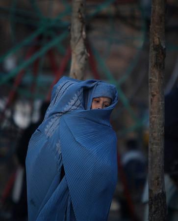 APTOPIX_Afghanistan_AQX107.JPG An Afghan woman holds her baby inside her burqa as she walks on a street in Kabul, Afghanistan, Monday, Feb. 1, 2010 (AP Photo/Altaf Qadri)